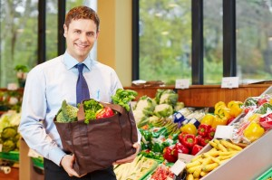 9600226-businessman-buying-bag-of-vegetables-in-organic-food-store