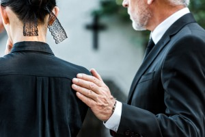 Cropped,View,Of,Man,Touching,Woman,On,Funeral